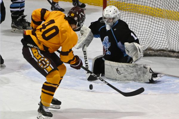 Dimond forward Teague Porter had his shot stopped by Chugiak goaltender Daegen Love during during the first period at Ben Boeke Ice Arena on Tuesday, Feb. 4, 2020. (Bill Roth / ADN)