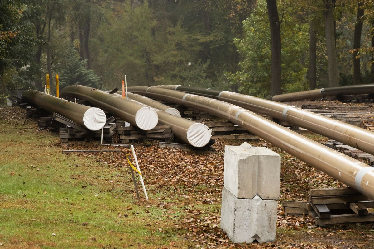 Pipes lie along a construction site on the Mariner East pipeline in a residential neighborhood in Exton, Pa. The 350-mile pipeline would carry natural gas liquids through suburbs and is close to schools, ballfields and senior care facilities. (AP Photo/Matt Rourke)