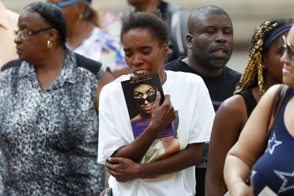 A member of the public becomes emotional viewing Aretha Franklin's coffin at Charles H. Wright Museum of African American History during a public visitation in Detroit, Tuesday, Aug. 28, 2018. Franklin died Aug. 16, of pancreatic cancer at the age of 76. (AP Photo/Paul Sancya, Pool)