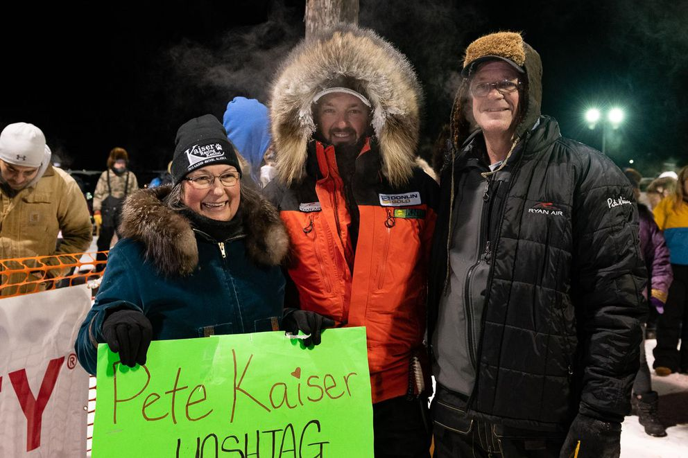 Pete Kaiser with his parents, Janet and Ron Kaiser, after winning his fifth Kuskokwim 300 dog sled race on January 19, 2020 in Bethel (Katie Basile / KYUK Public Media)