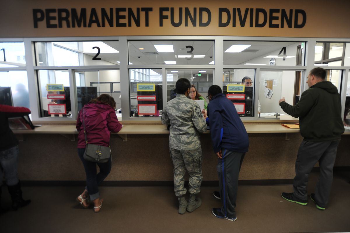Alaska residents get assistance applying for the Permanent Fund Dividend before the filing deadline on Tuesday, March 31, 2015, at the new PFD Anchorage Office in the Linny Pacillo Parking Garage at 7th Avenue and F Street.