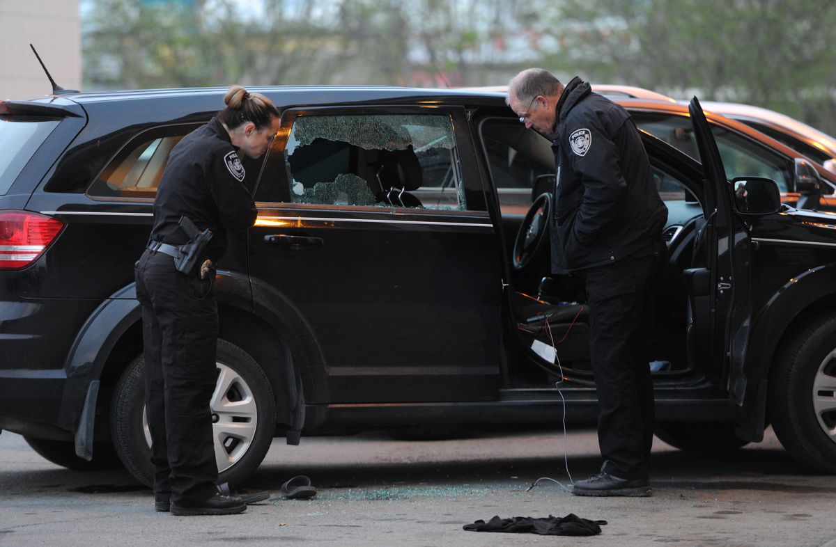 Anchorage police investigate a shooting in the 600 block of East Fifth Avenue late Wednesday. Two people were wounded, and a suspect was in custody, police said. (Bill Roth / ADN)