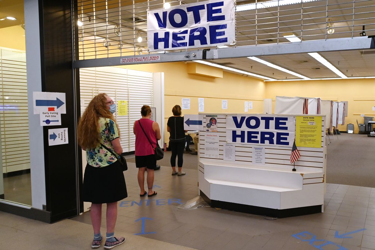Voters stood six feet apart as they waited in line to vote early in the Midtown Mall on Monday, August 17, 2020. (Bill Roth / ADN)