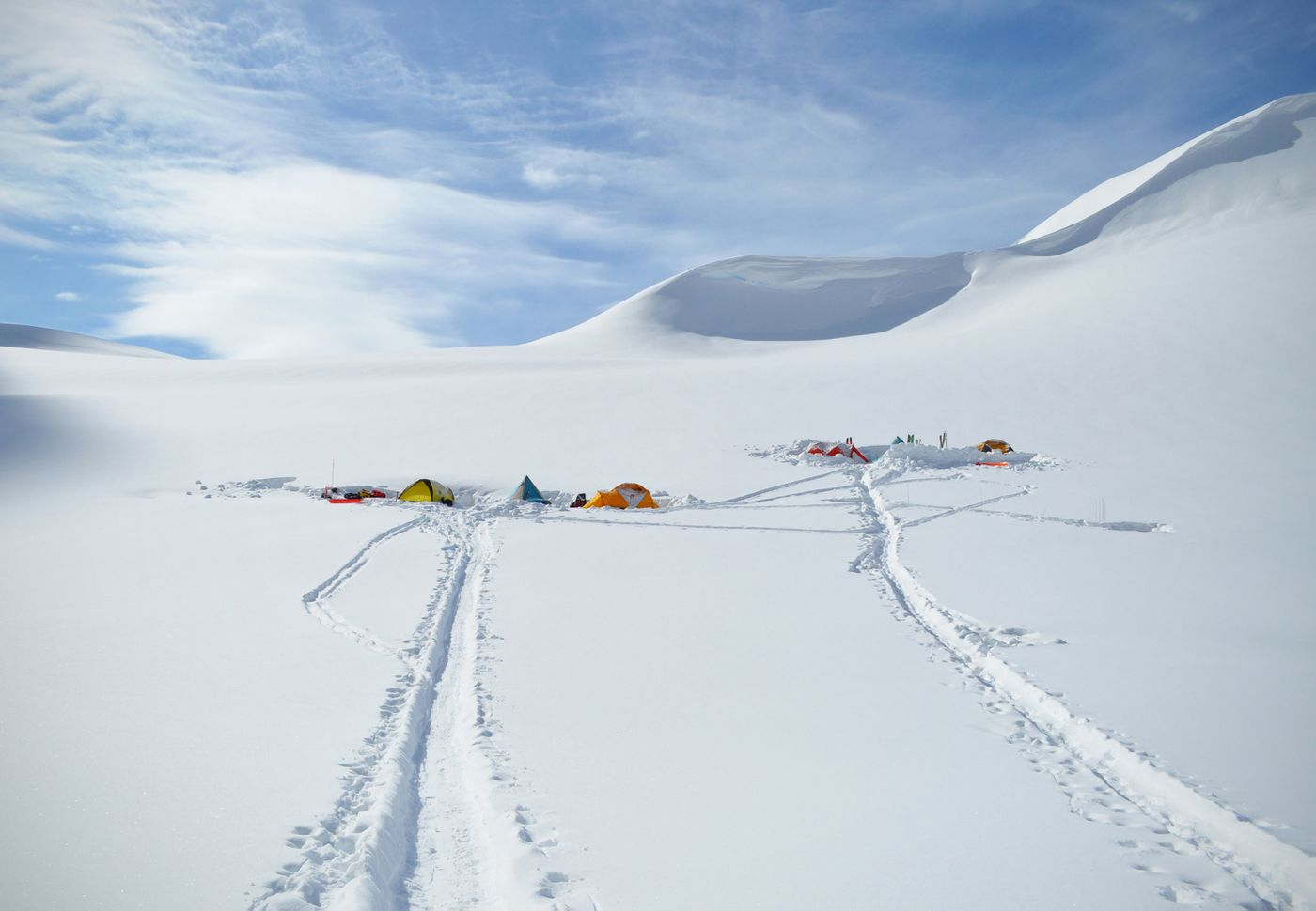 Multiple camps dug into the snow on Root Canal Glacier. (Vicky Ho / ADN)