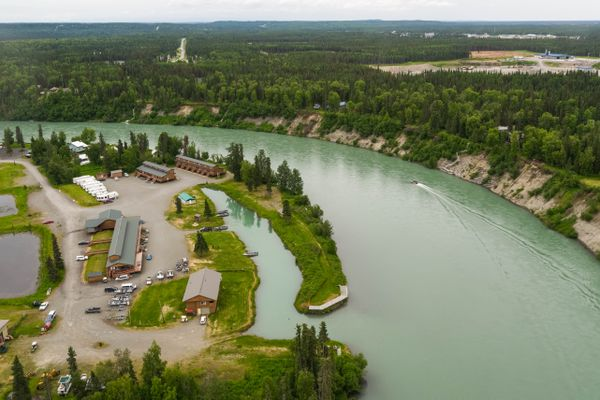 A fishing boat motors past RW's Fishing and Big Eddy Resort in Kenai on Friday, June 29, 2018. Guides at the resort, reacting to this summer's emergency king salmon closures, are getting creative, sending guests to other rivers or having them fish for other kinds of salmon, trout or halibut. (Loren Holmes / ADN)