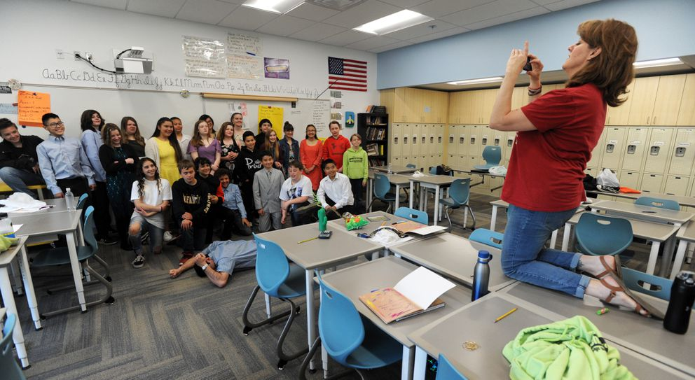 Kristen Dietsch, right, photographs husband Todd Dietsch's sixth-grade class as Todd, on floor, pretends to be at wit's end Tuesday morning May 22, 2019, at Gladys Wood Elementary School. Their son Michael Dietsch is a friend and classmate of Kohl Russell's. (Erik Hill)