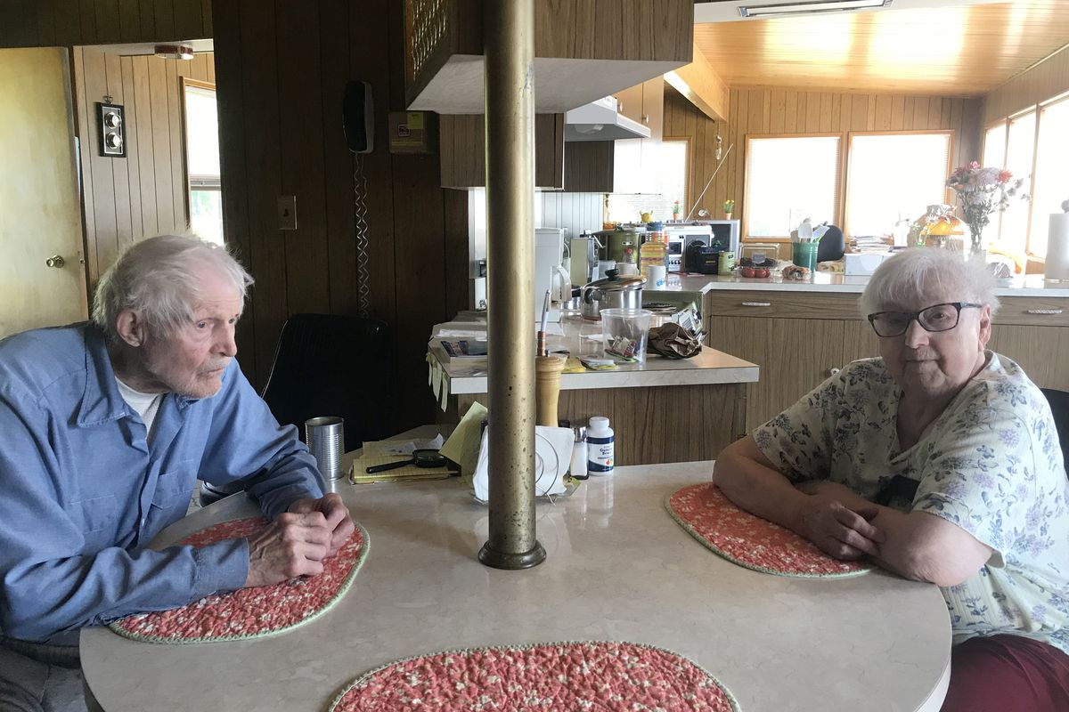 Ed and Val Musial sit at their kitchen table, June 26, 2019. Their home is endangered by the eroding banks of the Matanuska River. (Zaz Hollander / ADN)