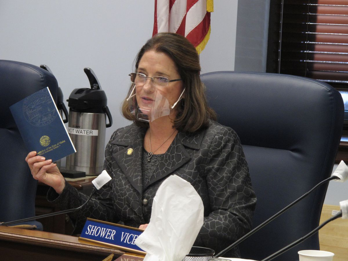 Alaska state Sen. Lora Reinbold, an Eagle River Republican, holds a copy of the Alaska Constitution during a committee hearing on Wednesday, Jan. 27, 2021, in Juneau, Alaska. Gov. Mike Dunleavy, a Republican, sent Reinbold a letter on Feb. 18, 2021, saying she has used her position to