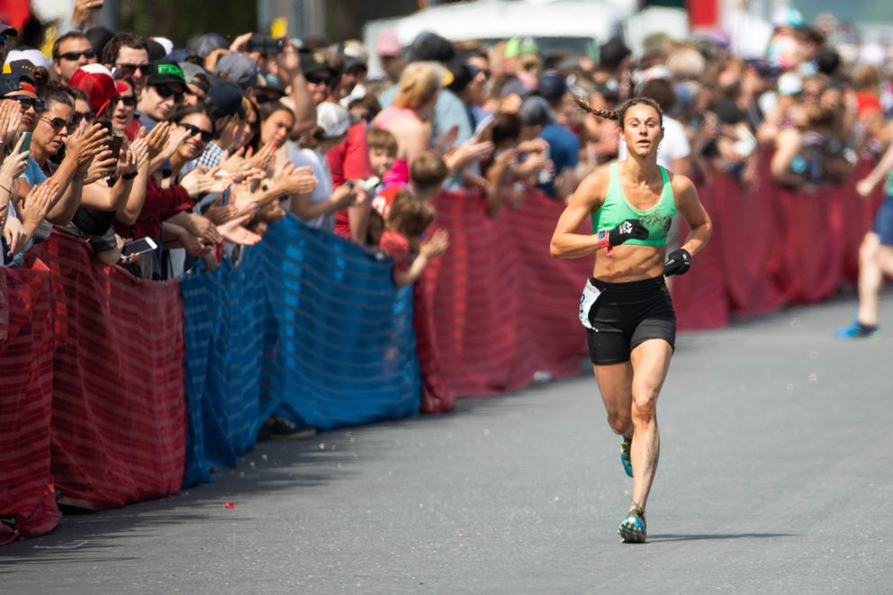 Jessica Yeaton runs down the finish chute to win the Mount Marathon race. (Loren Holmes / ADN)