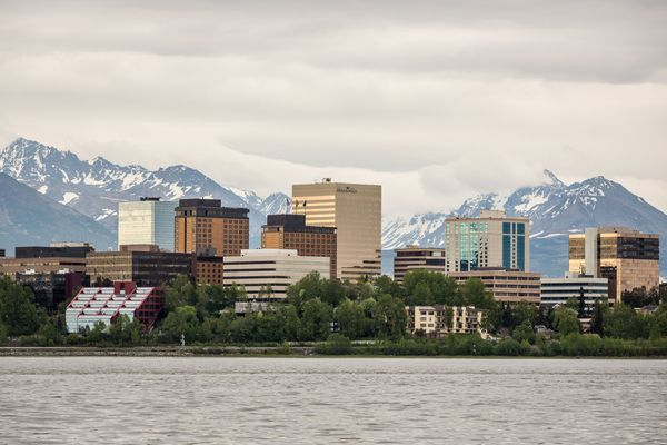 LOREN HOLMES / Alaska Dispatch Downtown Anchorage, Alaska, viewed from a small boat in lower Knik Arm on May 29, 2014.