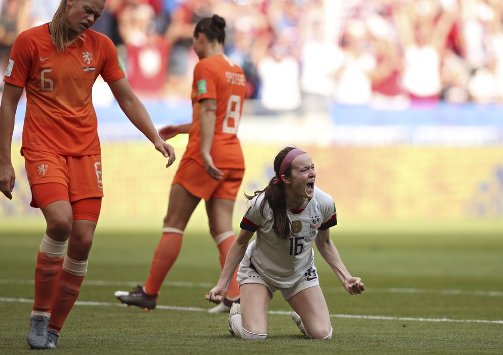 United States' Rose Lavelle, right, celebrates after scoring her side's second goal during the Women's World Cup final soccer match between US and The Netherlands at the Stade de Lyon in Decines, outside Lyon, France, Sunday, July 7, 2019. (AP Photo/Francisco Seco)