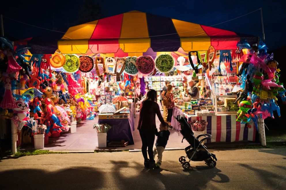 A novelty gifts booth glows at night at the Alaska State Fair on August 28, 2018. (Marc Lester / ADN)