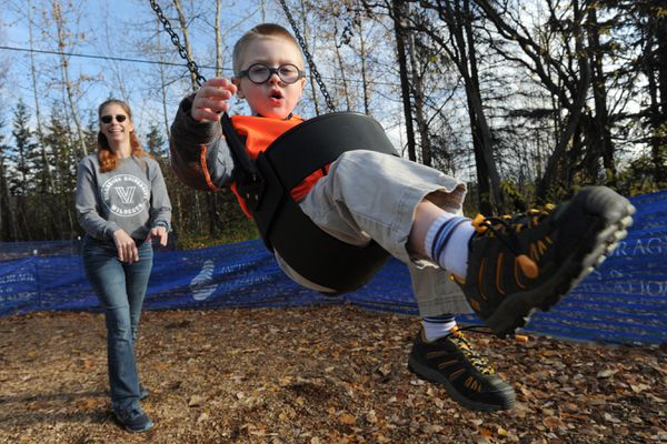 Danna Hoellering pushes her six-year-old grandson Daniel on a swing during a visit to a neighborhood park on Sunday, Oct. 11, 2020. (Bill Roth / ADN)