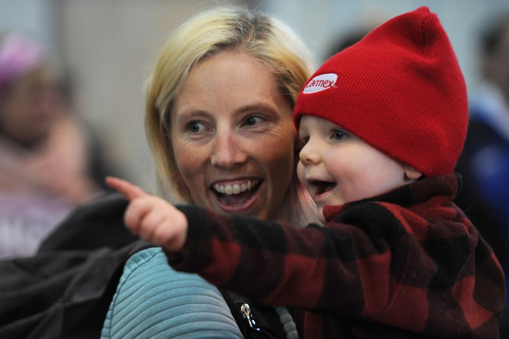 Five-time Olympian Kikkan Randall holds her 2-year-old son Breck on Sunday, April 1, 2018, after being reunited at the airport while returning to Anchorage for the first time since winning a gold medal in the women's team sprint cross-country skiing event at the Winter Olympics. (Bill Roth / ADN)