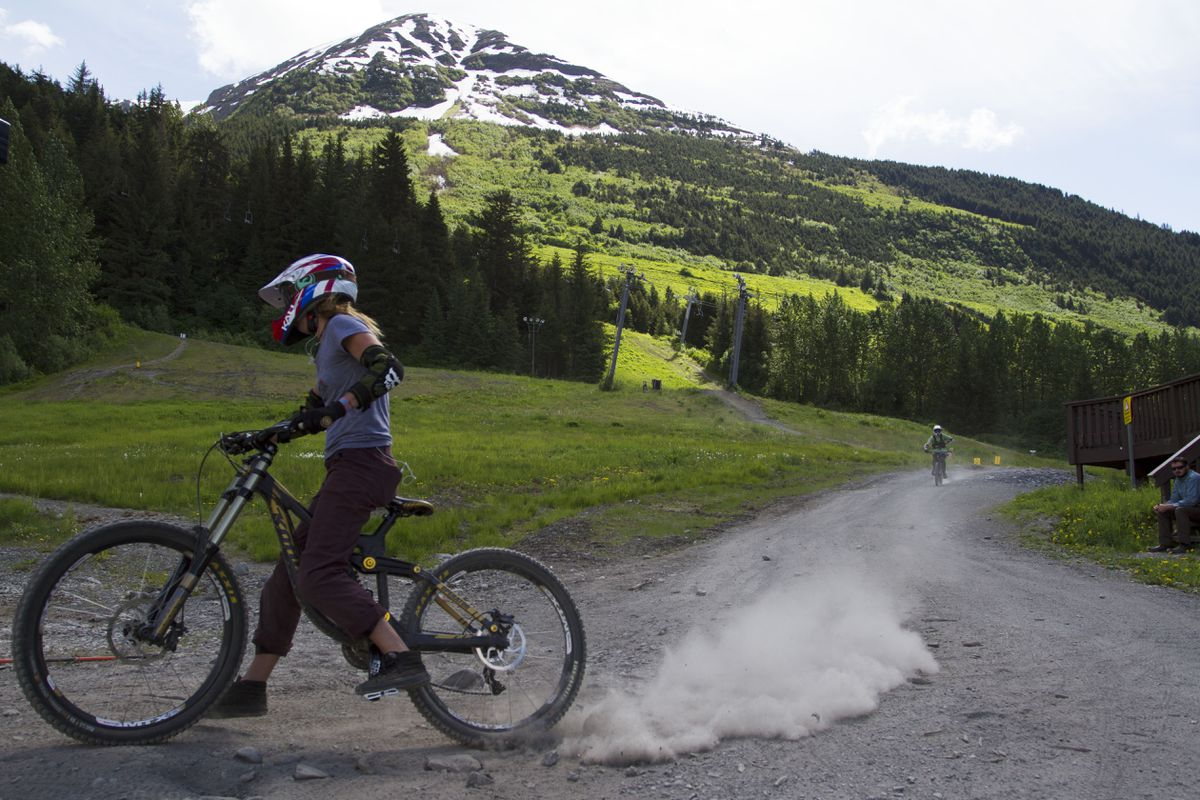 A biker swerves back in line for the lift after going down Chips N Salsa trail at the Alyeska Bike Park. (Sarah Bell / ADN)