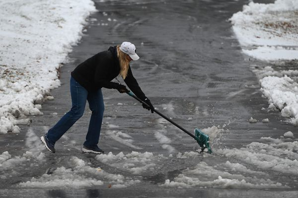 Teresa Severson shoveled slushy snow from a driveway on the Lower Hillside as it rained on Monday, Oct. 26, 2020.