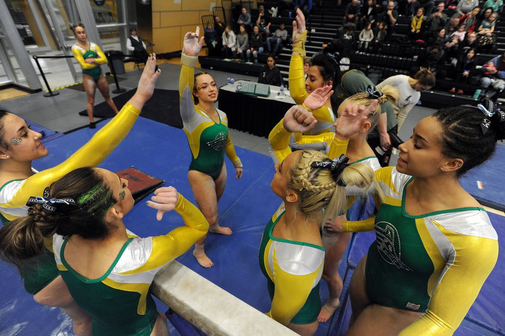 The UAA Seawolves prepare to compete on the beam during a dual-meet loss to Southeast Missouri State at the Alaska Airlines Center on Sunday, Jan. 12, 2020. (Bill Roth / ADN)