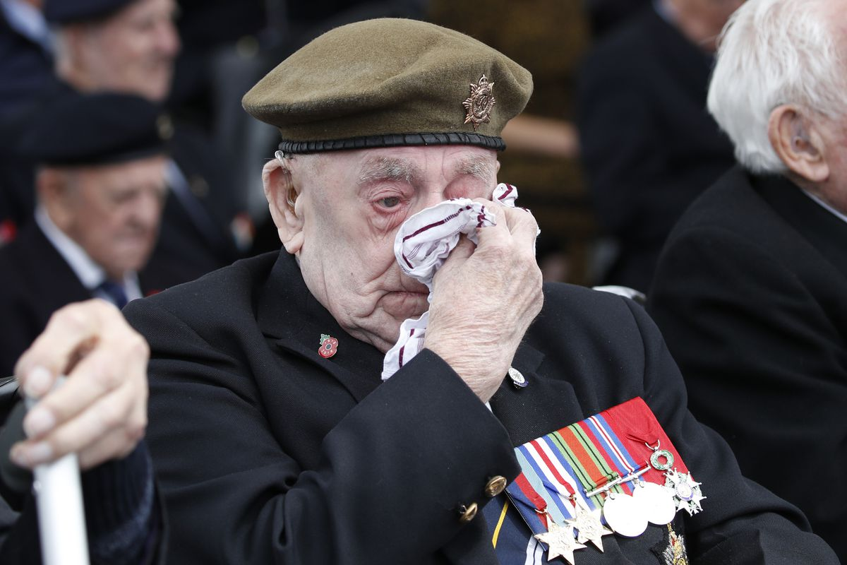 A veteran wipes his eyes during a ceremony to mark the 75th anniversary of D-Day, Wednesday, June 5, 2019, in Portsmouth, England. (AP Photo/Alex Brandon)