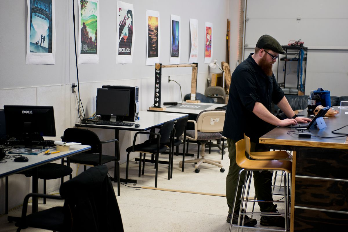 Caleb Lovelace works on a design that will be uploaded to a laser cutter in a class at Anchorage MakerSpace on April 6. (Marc Lester / Alaska Dispatch News)