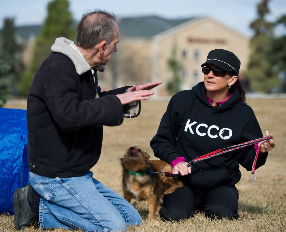"""Mike Gervell talks with Midnight Sun Service Dogs founder and instructor April Gettys during a training session on Tuesday, April 28, 2015, in Anchorage. """"You don't get over PTSD,"""" Gettys said. """"Your traumatic event will stay with you. But you can certainly learn how to relive life."""""""