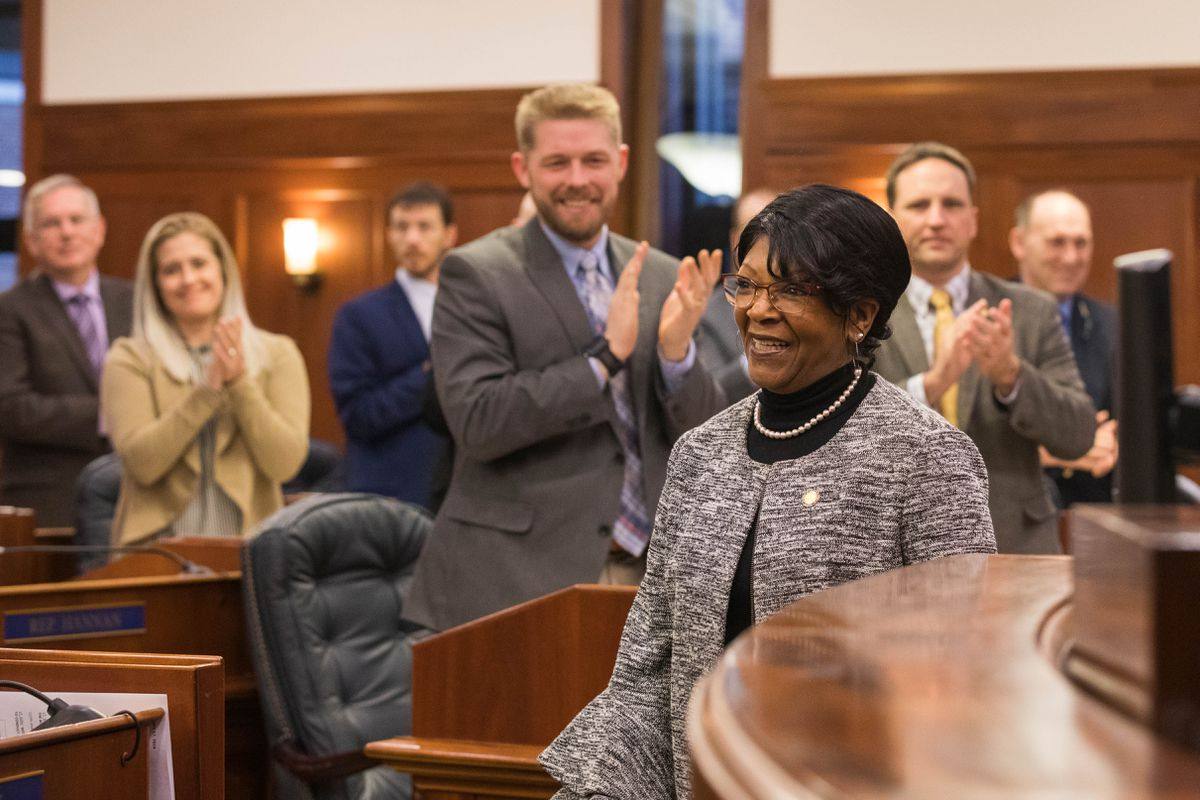 Rep. Sharon Jackson, R-Eagle River, is applauded by her colleagues after she took the oath of office from House Speaker Pro Tempore Rep. Neal Foster Thursday, Jan. 17, 2019 at the Alaska State Capitol. Jackson was nominated by Gov. Mike Dunleavy to fill a seat vacated by Nancy Dahlstrom, but she was not sworn in on the first two days of the session because the House could not agree on a Speaker Pro Tempore, which is required for procedural reasons. (Loren Holmes / ADN)