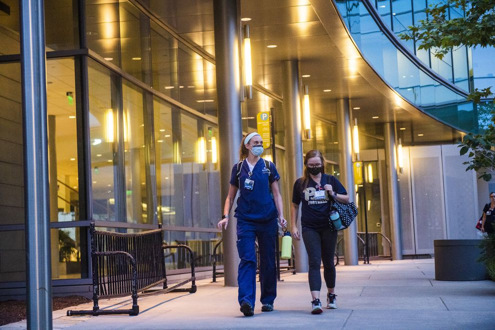 Nurse Kelly Williams, left, and friend and co-worker, Emma Cranston, exit The Johns Hopkins Hospital following Williams shift in the emergency department. (Photo for The Washington Post by Amanda Voisard)