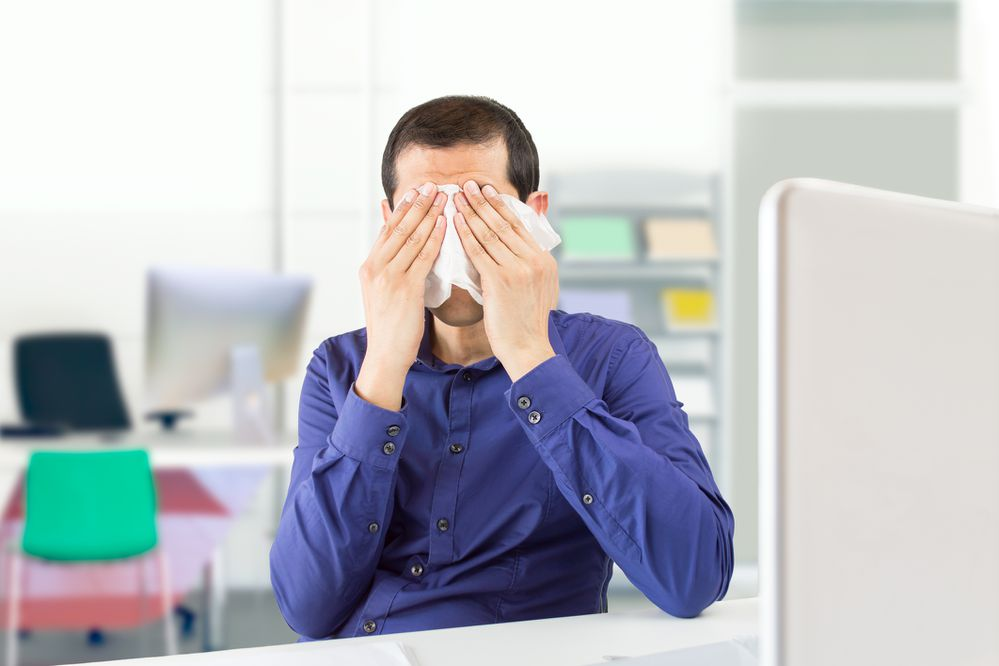 Generic stock image of tired businessman sitting at the office covering his face while crying. (iStock)