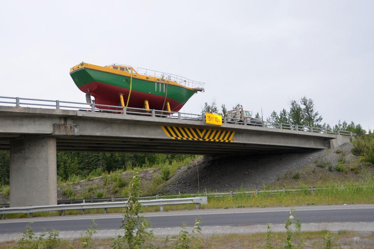 Deere John sails across the Eklutna overpass and onto the Glenn Highway on June 27, 2017. (Rick Sinnott)