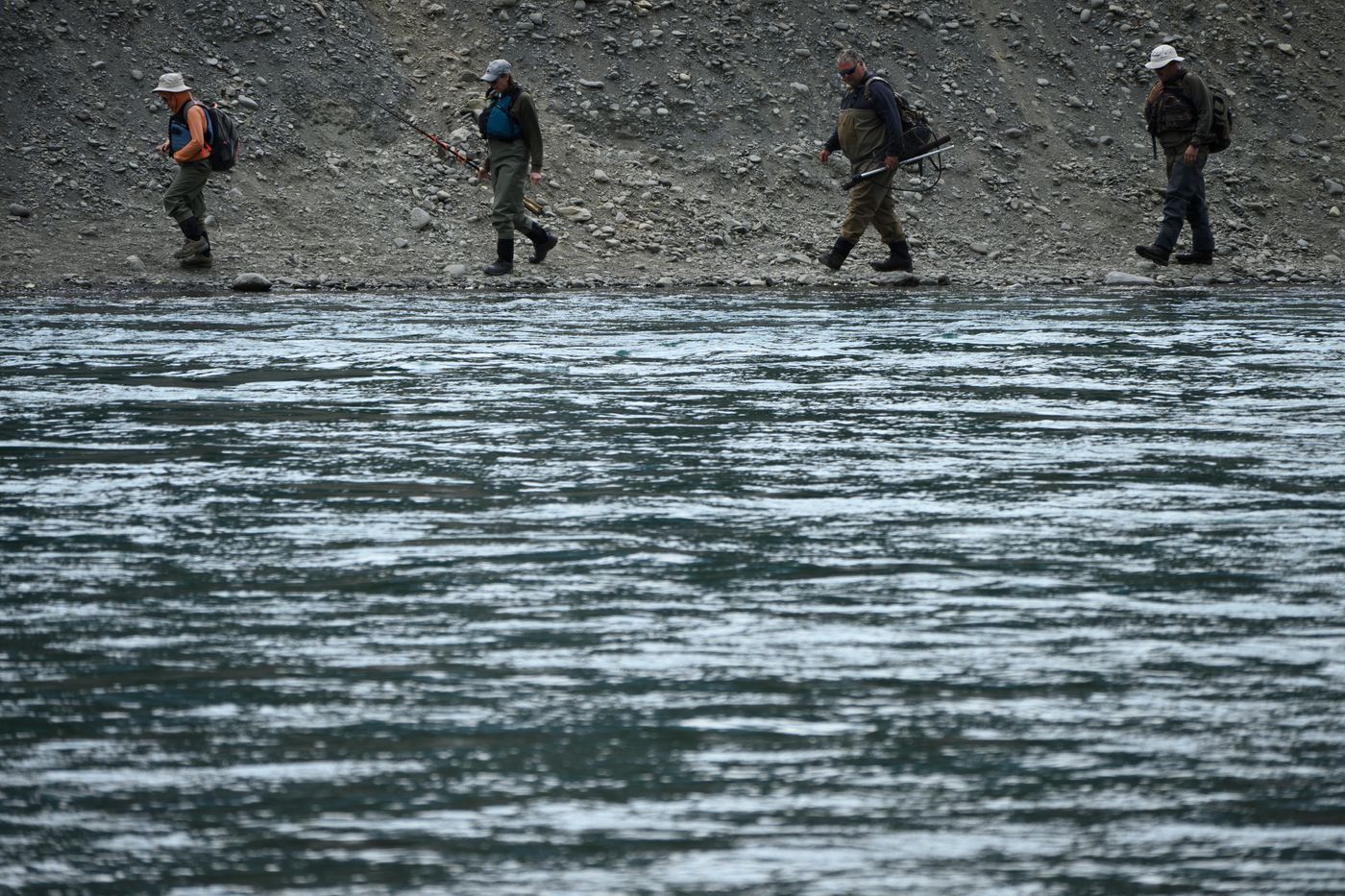 Fishermen walk the bank of the Kenai River near the Russian River confluence. (Marc Lester / ADN)