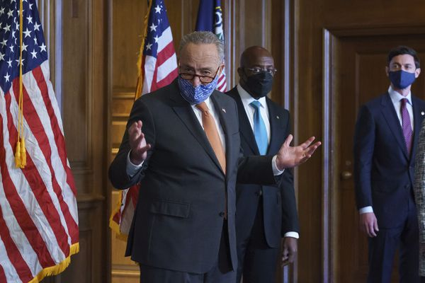 On the first full day of the Democratic majority in the Senate, Majority Leader Chuck Schumer, D-N.Y., left, is joined by Sen. Raphael Warnock, D-Ga., center, and Sen. Jon Ossoff, D-Ga., during a press event at the Capitol in Washington, Thursday, Jan. 21, 2021. The pivotal Georgia runoff election this month was decisive in handing Democrats the majority in the Senate. (AP Photo/J. Scott Applewhite)