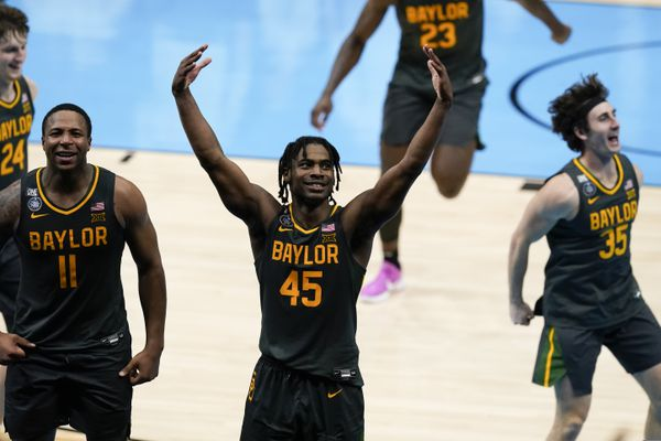 Baylor guard Davion Mitchell (45) celebrates at the end of the championship game against Gonzaga in the men's Final Four NCAA college basketball tournament, Monday, April 5, 2021, at Lucas Oil Stadium in Indianapolis. Baylor won 86-70. (AP Photo/Darron Cummings)