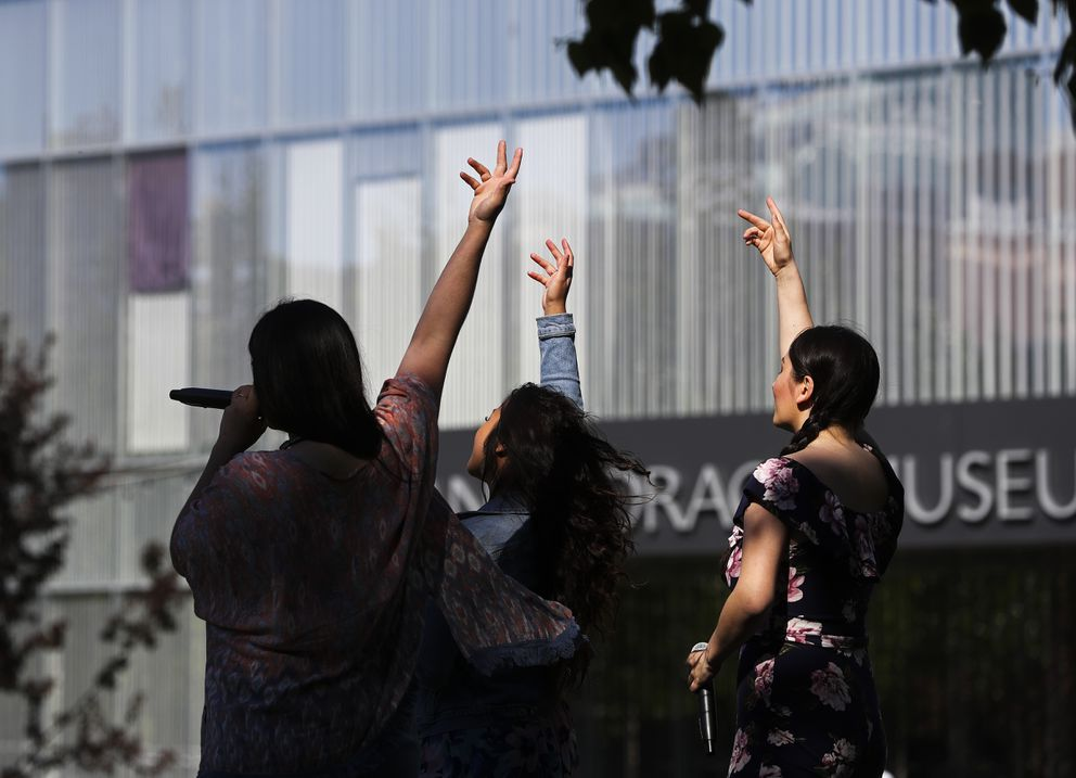 Molly Dieni, left, Audrey Latonio, center, and Lisa Hawkins, right, members of the contemporary a cappella trio Pipeline Vocal Project, perform on Friday. (Emily Mesner / ADN)