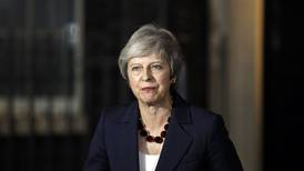 Britain's May secures Cabinet backing for Brexit deal as critics rage