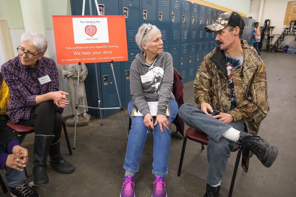 Leslie Haskins, right, talks with volunteer Patricia Kennish at the listening post at Brother Francis Shelter on Tuesday. At left is Sandy Morris, also a volunteer. (Loren Holmes / ADN)