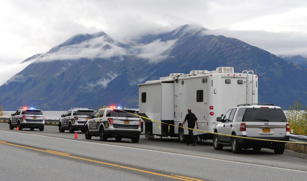 Anchorage Police investigate the scene where human remains were found at mile 108 of the Seward Highway near Rainbow. (Bill Roth / ADN)