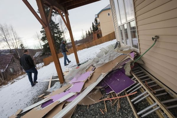 Eagle River homeowner Duncan Whitney, left, and structural engineer Jake Horazdovsky walk around Whitney's home during an inspection Tuesday, Dec. 4, 2018. Whitney removed cracked drywall from his home's most-damaged room, looking for hidden structural damage. (Loren Holmes / ADN)