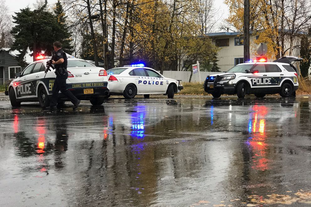 Anchorage police at a shooting near 13th Ave. and Ingra Street, Oct. 10, 2018. (Bill Roth / ADN)