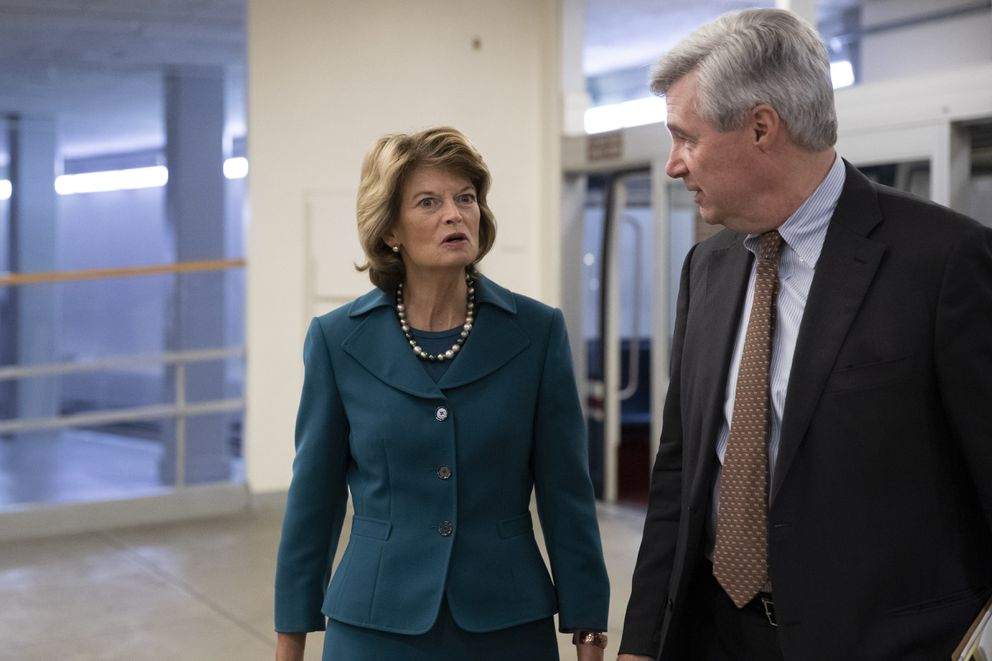 Sen. Lisa Murkowski, R-Alaska, left, and Sen. Sheldon Whitehouse, D-R.I., walk on Capitol Hill, Tuesday, Feb. 4, 2020, in Washington. (AP Photo/Alex Brandon)