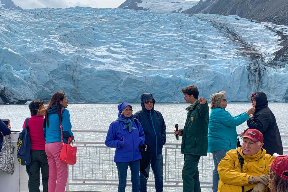 Ranger interpreter Sage Harmon talks to passengers aboard the MV Ptarmigan during a glacier viewing cruise Wednesday, Aug. 14, 2019 in Portage Lake. (Jeff Parrott / ADN)