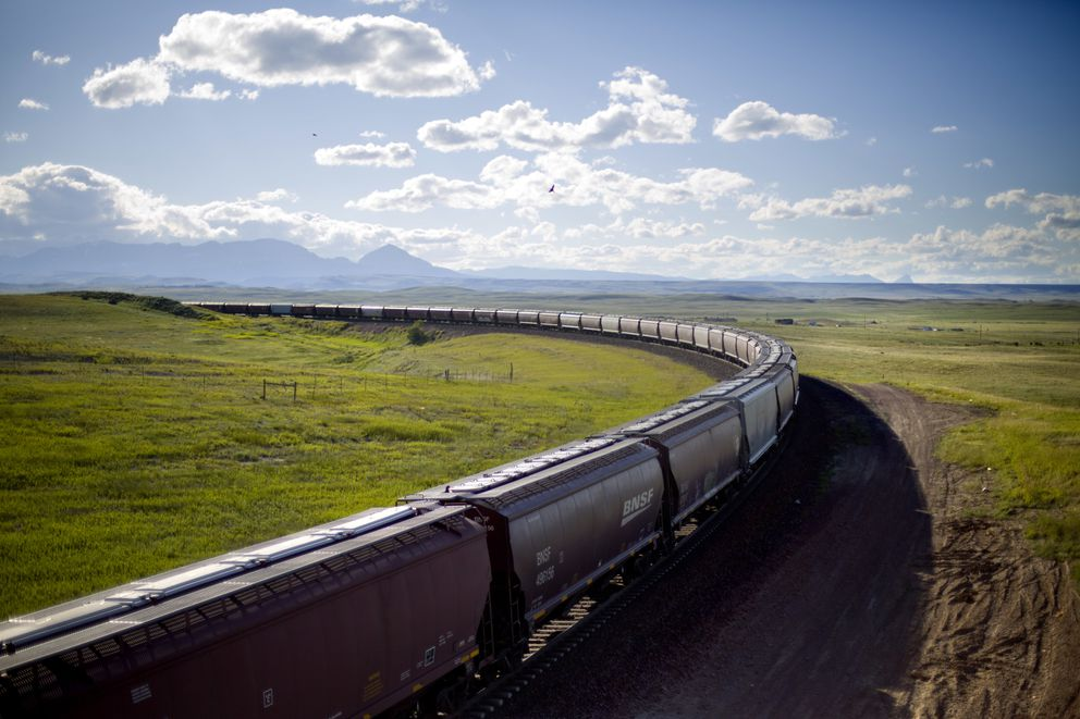 A train rounds a bend while traveling across the landscape of the Blackfeet Indian Reservation in Browning, Mont., Tuesday, July 10, 2018. Tribal police and investigators from the federal Bureau of Indian Affairs serve as law enforcement on reservations, which are sovereign nations. But the FBI and U.S. Department of Justice investigate certain offenses and, if there's ample evidence, prosecute major felonies such as murder, kidnapping and rape if they happen on tribal lands. (AP Photo/David Goldman)