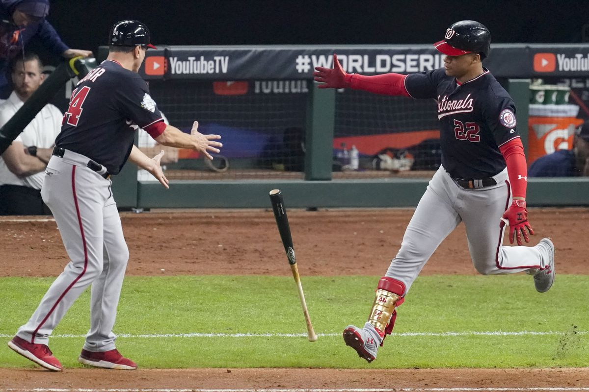 Washington Nationals' Juan Soto tosses his bat to first base coach Tim Bogar after his home run against the Houston Astros during the fifth inning of Game 6 of the baseball World Series Tuesday, Oct. 29, 2019, in Houston. (AP Photo/Eric Gay)