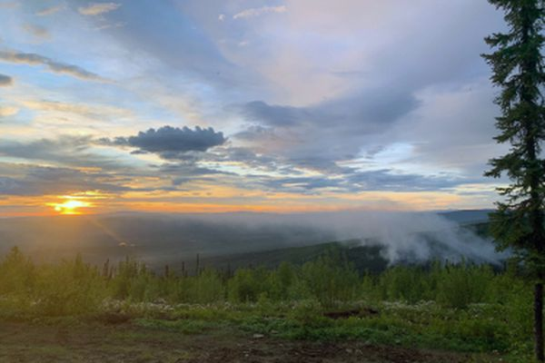Light smoke from the Any Creek Fire burning near Old Murphy Dome Road north of Fairbanks rises late Saturday night following an aggressive aerial and ground assault. Photo by Thomas Krock/Alaska Division of Forestry