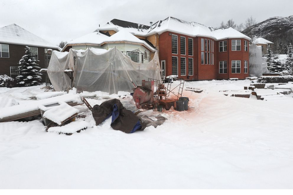 Repair work continues to an Eagle River home on Tuesday, Nov. 19, 2019, that was damaged by the 7.1 earthquake that shook Southcentral nearly a year ago. (Bill Roth / ADN)