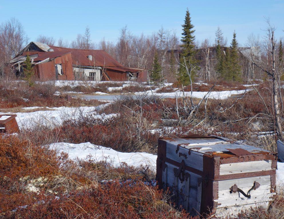 A travel trunk on the tundra in the ghost town of Iditarod. (Ned Rozell)
