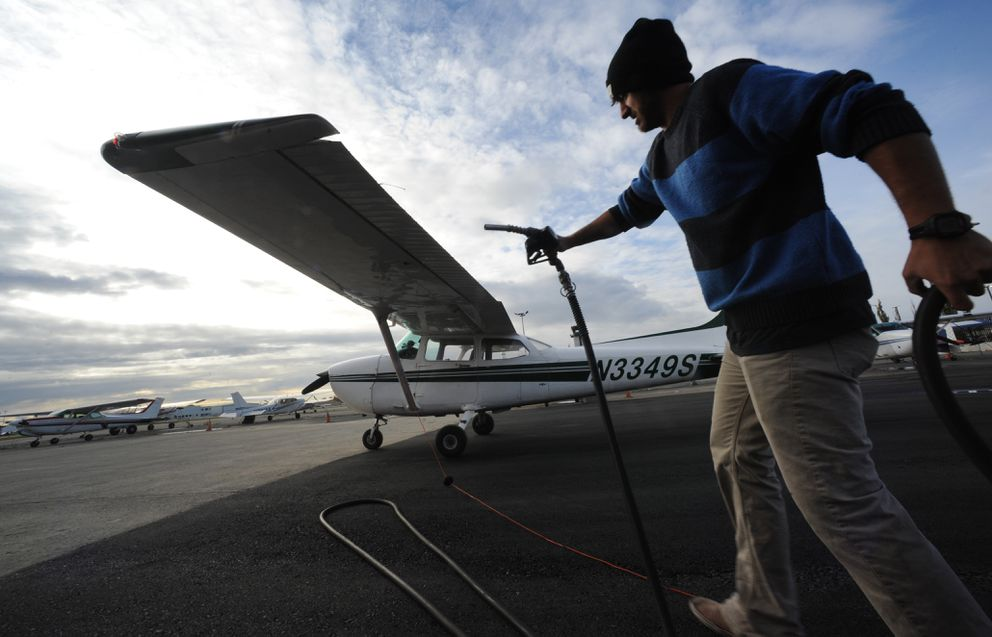 Student pilot Cole Harkovitch fuels a Cessna 172 before going up in the air with a flight instructor from Land and Sea Aviation Alaska at Merrill Field. (Bill Roth / Alaska Dispatch News)