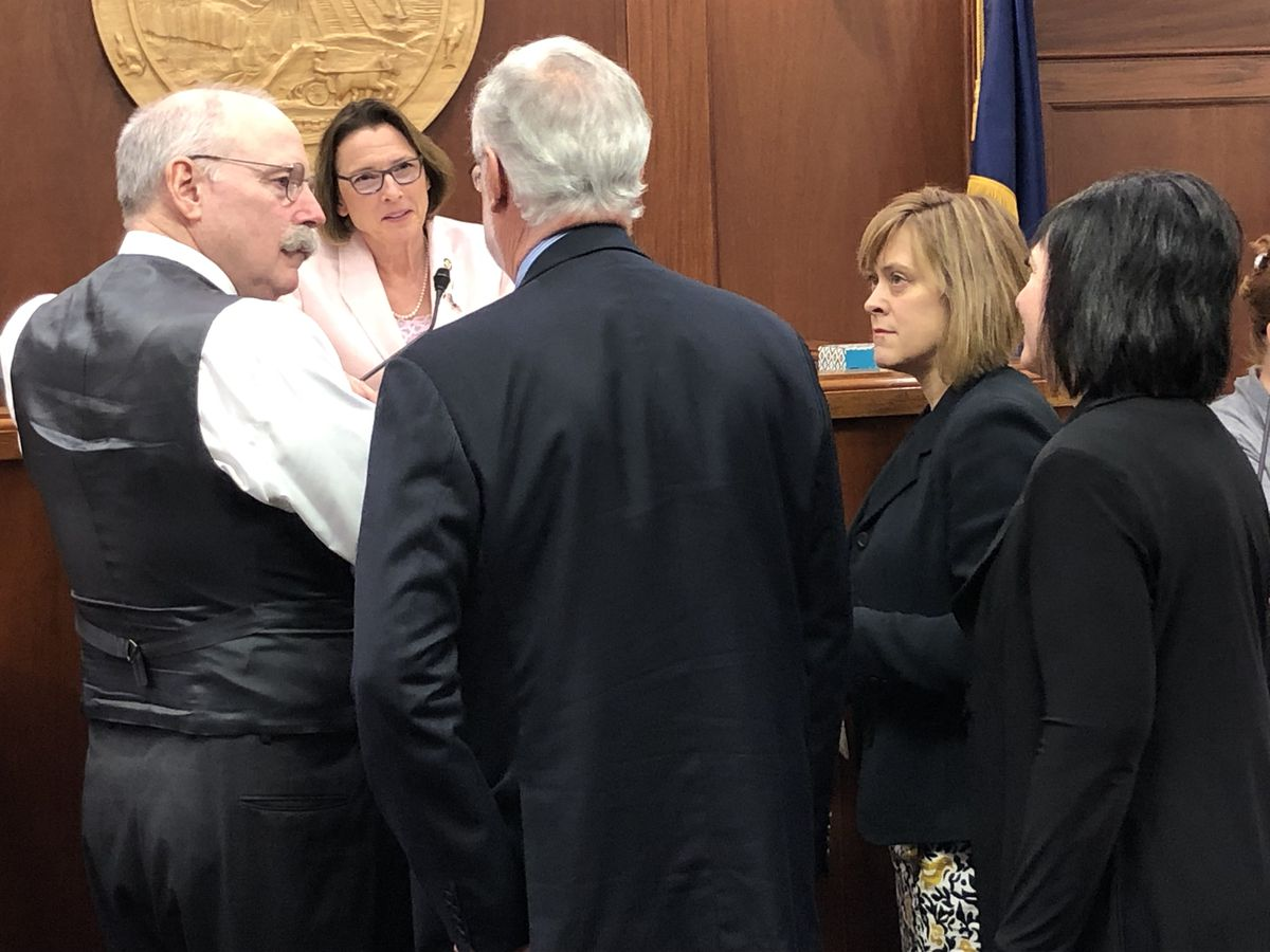 Senate President Cathy Giessel, R-Anchorage, speaks to several senators on Tuesday morning, June 4, 2019 after the passage of a budget amendment calling for a $3,000 Permanent Fund Dividend. (James Brooks / ADN)