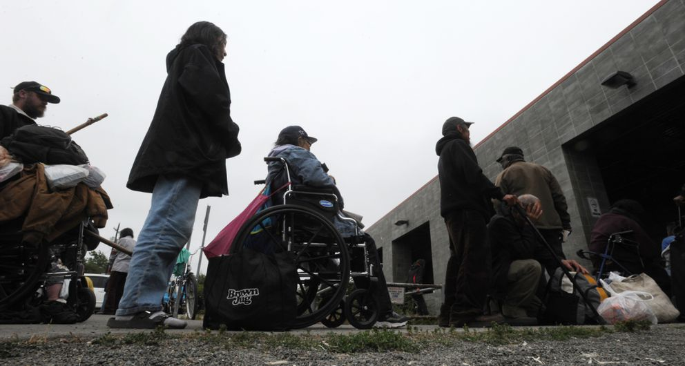 Clients wait in line for the doors to open at the Brother Francis Shelter on Thursday afternoon, July 11, 2019. (Bill Roth / ADN)