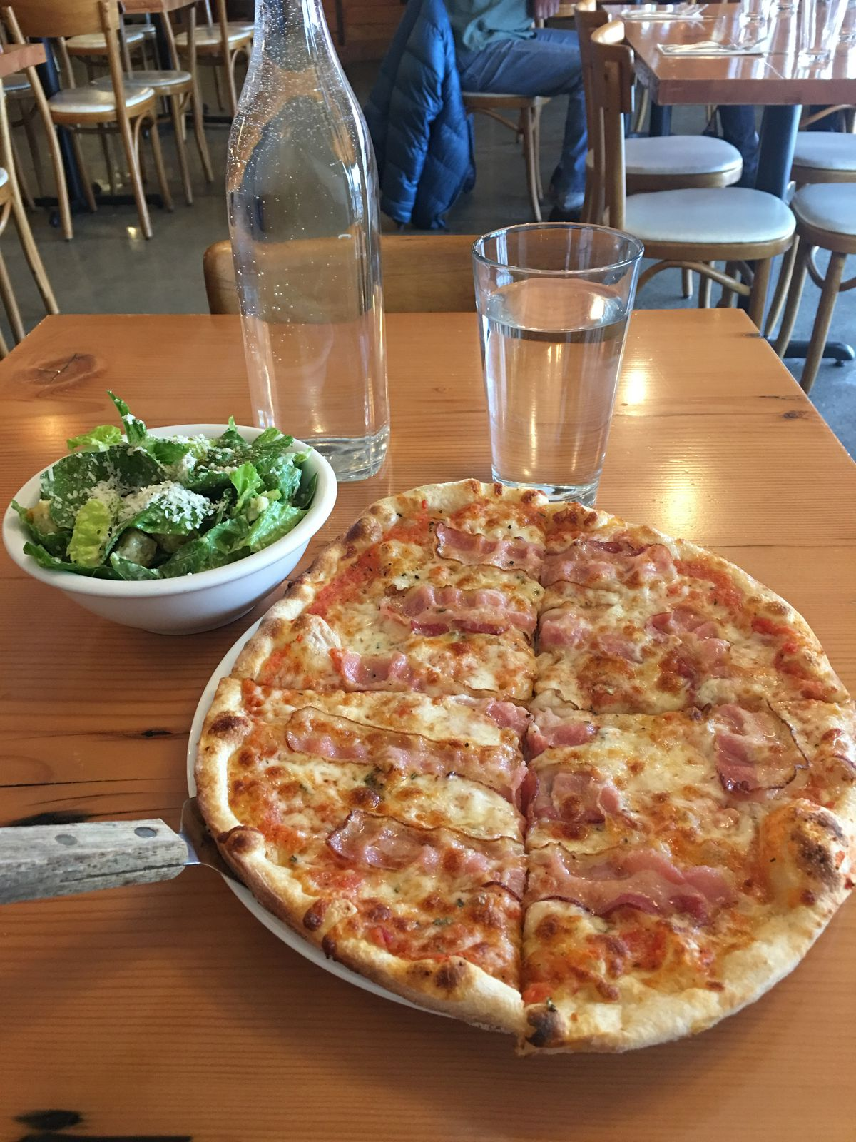 """The lunch special at Hearth includes a personal pan pizza (including the """"Little Piggy"""" pizza) and side salad for $10. (Photo by Mara Severin)"""