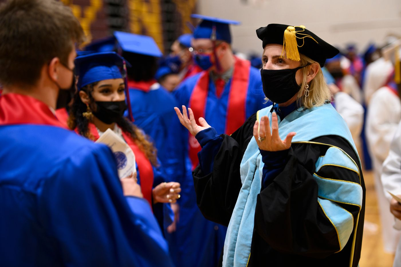 Anchorage School District superintendent Deena Bishop speaks with East High School students before the start of their graduation ceremony. (Marc Lester / ADN)