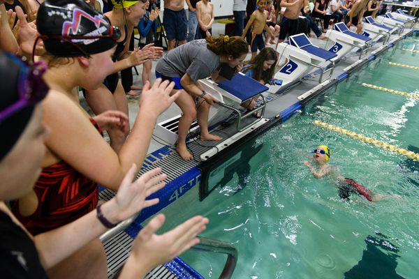 Zachary Kemp, 5 reaches the end of his race as others applaud. The Northern Lights Swim Club hosted the Aqua Dog 50 Free Sprint Tournament at the Service High School on April 12, 2019. (Marc Lester / ADN)